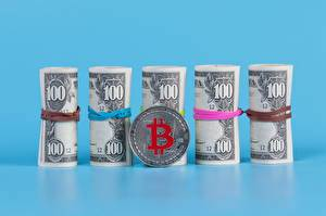 Money_Banknotes_Dollars_Bitcoin_Coins_Colored_601966_600x399.jpg