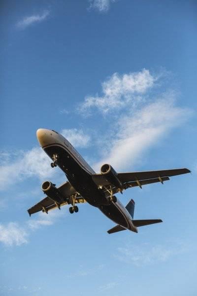 depositphotos_43865997-stock-photo-airplane-flying-with-blue-sky.jpg